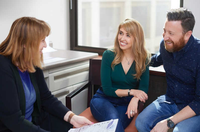 A man and woman consulting with a specialist